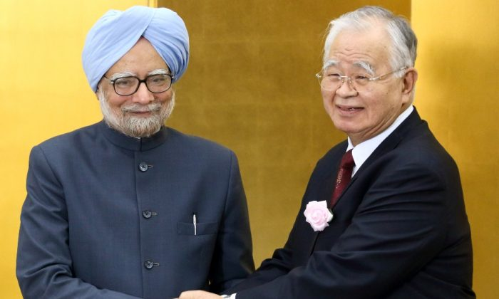 India's Prime Minister Manmohan Singh (L) shakes hands with Hiromasa Yonekura (R), chairman of Sumitomo Chemical Co. and chairman of the business lobby Keidanren, during a luncheon hosted by Keidanren, the Japan Chamber of Commerce and Industry (JCCI) and the Japan-India Business Co-operation Committee in Tokyo on May 28, 2013. Singh is on a four-day visit to Japan. (Tomohiro Ohsumi/AFP/Getty Images)
