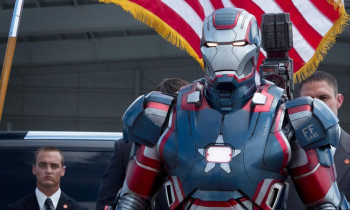 "Colonel James ""Rhodey"" Rhodes as Iron Patriot (Don Cheadle) in the science-fiction action-adventure ""Iron Man 3,"" is the Liaison between the U.S. Air Force and Stark Industries. (Courtesy of Marvel)"
