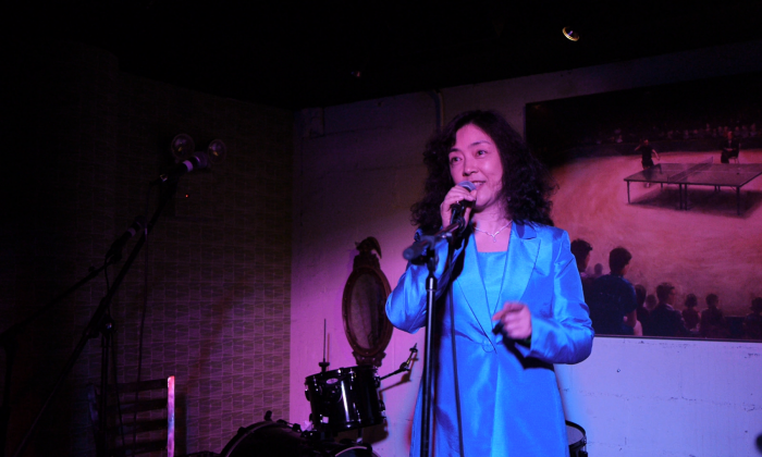 Jennifer Zheng, author and Chinese slave labour camp survivor, speaking at an ICONS Unite human rights music event in Manhattan on May 19. (Mathias Magnason)