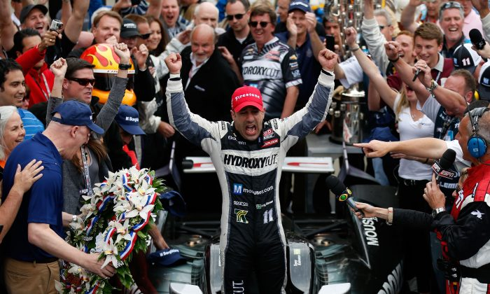 Tony Kanaan, driver of the Hydroxycut KV Racing Technology-SH Racing Chevrolet, celebrates in victory circle after winning the 97th running of the IZOD INDYCAR Series Indianapolis 500-mile race at the Indianapolis Motor Speedway on May 26, 2013, in Indianapolis, Ind. (Chris Graythen/Getty Images)