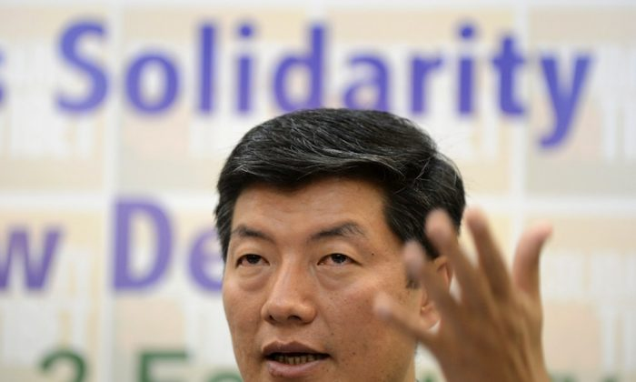 """Lobsang Sangay, prime minister of the Tibetan government-in-exile, during a press conference in New Delhi on Jan. 29, 2013. Sangay said in Washington recently that he hopes to have peaceful dialogue with the Chinese Communist Party about """"genuine autonomy"""" for the region. (Sajjad Hussain/AFP/Getty Images)"""