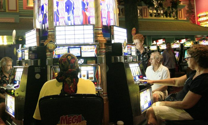 A file photo of people playing slot machines at a casino in Atlantic City, New Jersey, on Aug. 17, 2010. Overall, New Jersey's 12 casinos reported a decline in gross profits for April 2013 over April 2012 figures, with the new Revel casino reporting a 40 percent decline. (Abdullah Pope/AFP/Getty Images)