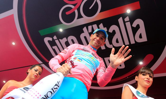 Vincenzo Nibali celebrates defending race leader's pink jersey after Stage 17 of the 96th Giro d'Italia. The Sicilian leader of the Astana team won Stage 18 by almost a minute, almost certainly enduring that he will keep the leader's jersey until the race ends in Brescia on Sunday. (Luk Benies/AFP/Getty Images)