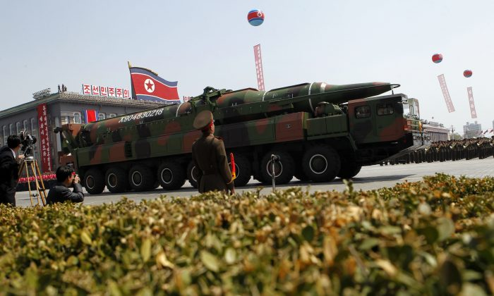 In this Sunday, April 15, 2012 file photo, a North Korean vehicle is shown carrying what appears to be a new missile. (AP Photo/Ng Han Guan, File)
