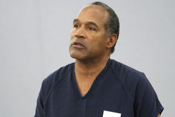A file photo of O.J. Simpson speaking during his sentencing at the Clark County Regional Justice Center courtroom in Las Vegas on Dec. 5, 2008. On May 13, 2013, Simpson is heading back to the Las Vegas courthouse where he was convicted of leading five men in an armed sports memorabilia heist to ask a judge for a new trial because, he says, the Florida lawyer he paid nearly $700,000 botched his defense.(AP Photo/Isaac Brekken, Pool, File)
