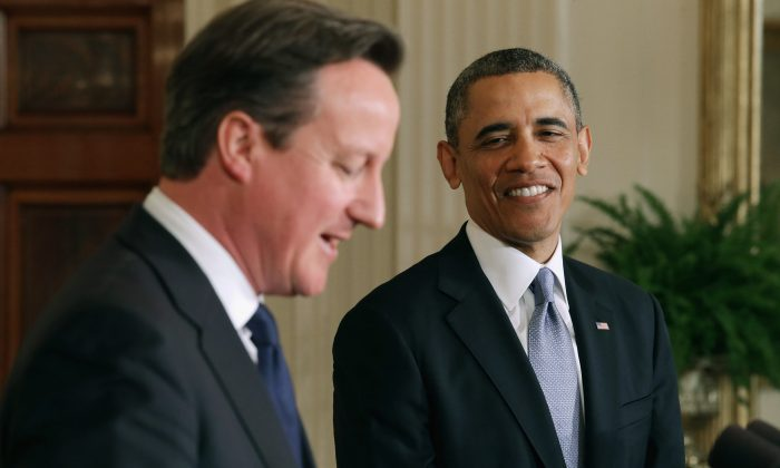 U.S. President Barack Obama and British Prime Minister David Cameron hold a joint news conference in the East Room at the White House in Washington, D.C., on May 13, 2013. (Chip Somodevilla/Getty Images)