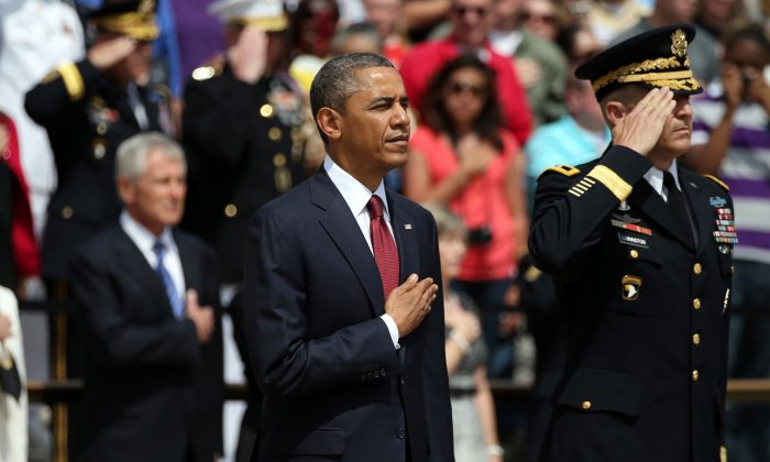 U.S. President Barack Obama and Major Gen. Michael S. Linnington stand before a wreath ceremony on Memorial Day at the Tomb of the Unknowns at Arlington National Cemetery on May 27, 2013. (Mark Wilson/Getty Images)