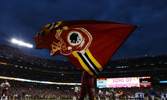 A Washington Redskins flag is waved prior to the NFC Wild Card Playoff Game against the Seattle Seahawks at FedExField in Landover, Md., on January 6, 2013. (Al Bello/Getty Images)