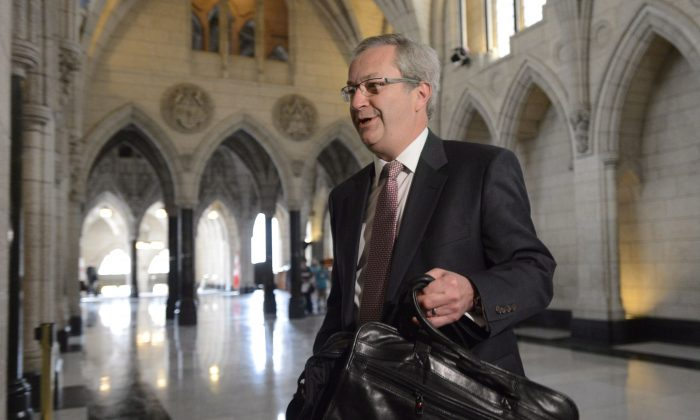 Chief electoral officer Marc Mayrand arrives at the Commons house affairs committee in Ottawa on Tuesday May 28, 2013. Mayrand confirmed for the first time that Conservative party workers have failed to co-operate with an investigation into fraudulent robocalls. (THE CANADIAN PRESS/Adrian Wyld)