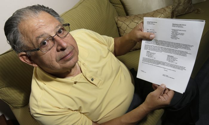 Tim Savaglio, a member of the Liberty Township Tea Party, displays one of the letters his group received from the IRS at his home in West Chester, Ohio, May 15. (AP Photo/Al Behrman)