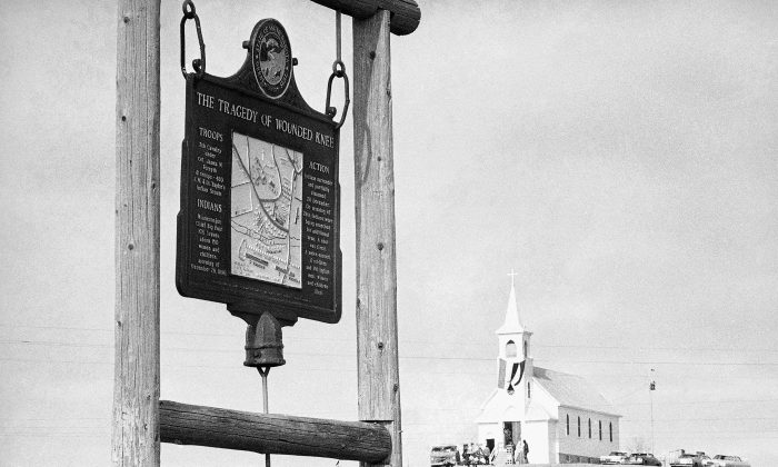 This undated file photo shows the historical marker commemorating the Wounded Knee Massacre of 1890. (AP Photo/File)