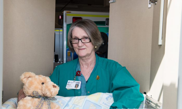 """An emergency unit supervisor poses with the newly opened """"angel cradle"""" at the Grey Nuns Hospital in Edmonton on May 6, 2013. (Courtesy of Adam Swanson/Covenant Health)"""