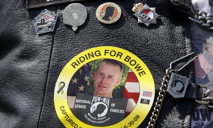 The image of Army Sgt. Bowe Bergdahl of Hailey, Idaho, who is being held captive in Afghanistan, is worn by an audience member as his father Bob, not pictured, speaks at the the annual Rolling Thunder rally for POW/MIA awareness, in Washington, Sunday, May 27, 2012. (AP Photo/Charles Dharapak)