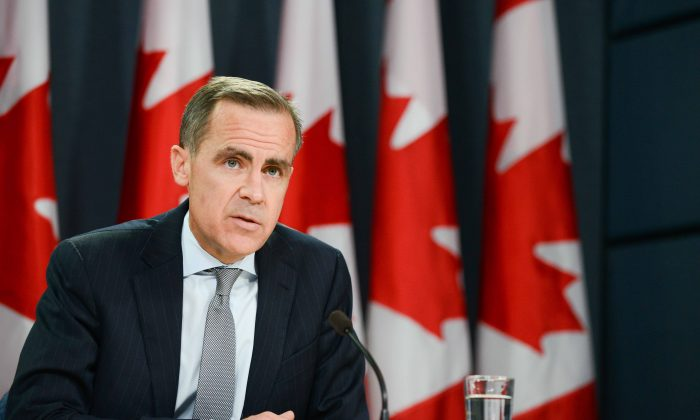 Outgoing Bank of Canada Governor Mark Carney speaks at the National Press Theatre in Ottawa on April 17. As expected, Carney's last public move at Canada's central bank on May 29 was to stick to the course he has charted since September 2010, keeping the trendsetting policy rate at one percent to induce continued borrowing and spending by consumers and businesses. (Matthew Little/The Epoch Times)