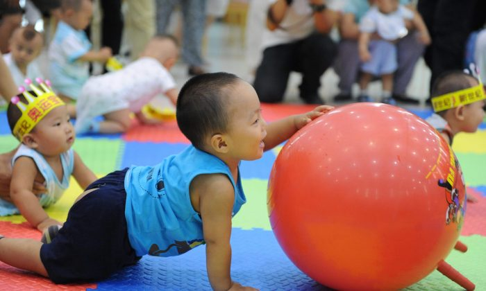 Chinese toddlers play at a Beijing nursery in 2009. Master of Business Administration preparatory classes for babies and toddlers have become popular in China among wealthy parents wanting to give their children a head start in education. (STR/AFP/Getty Images)