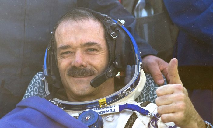 "Canadian spaceman Chris Hadfield gives a thumbs up shortly after his landing aboard the Russian Soyuz space capsule in central Kazakhstan on May 13, 2013. Hadfield became an international celebrity with his tweets from space and cover of David Bowie's ""Space Oddity."" (Sergei Remezov/AFP/Getty Images)"