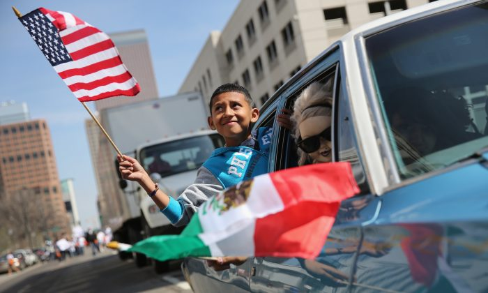 A boy rides in a low rider during a Cinco de Mayo parade in Denver, Colorado on May 4, 2013. (John Moore/Getty Images)