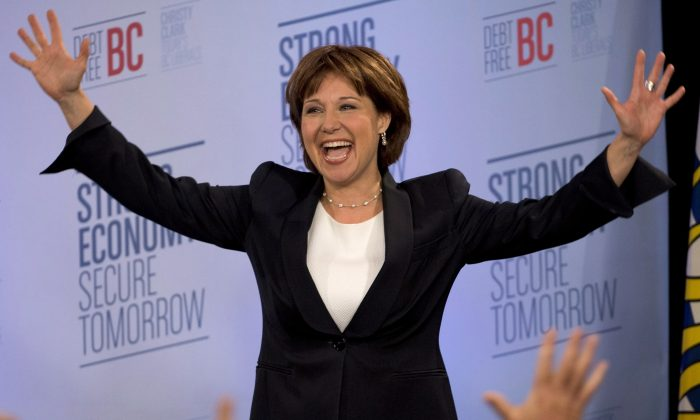 A triumphant Christy Clark waves to the crowd upon arriving on stage after winning the B.C. provincial election, in Vancouver on Tuesday.  (THE CANADIAN PRESS/Jonathan Hayward)