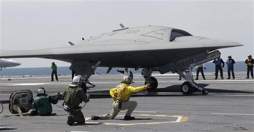 A Navy X-47B drone is launched off the nuclear powered aircraft carrier USS George H. W. Bush off the coast of Virginia. Attorney General Eric Holder said the United States considers drone strikes a viable option to target United States citizens outside the country who pose a threat to the U.S. and cannot feasibly be captured. (AP Photo/Steve Helber)