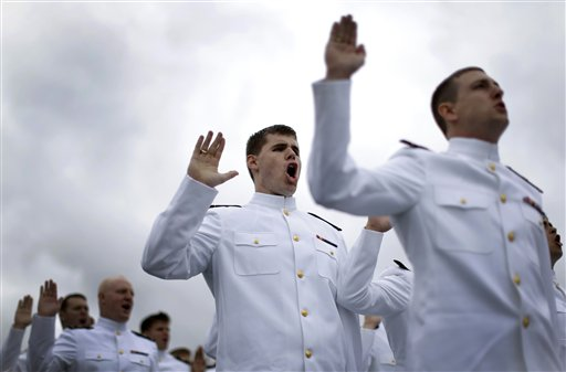Graduating U.S. Naval Academy Midshipmen take the U.S. Navy oath of office during the Academy's graduation and commissioning ceremonies, Friday, May 24, 2013, in Annapolis, Md. (AP Photo/Patrick Semansky)
