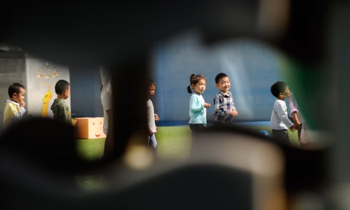 Children attend kindergarten in Beijing on Sept. 19, 2012. A recent spate of stabbings and killings in Chinese schools has led to deep questions about the prevailing value system, which experts say has been undermined by Communist Party policies. (Wang Zhao/AFP/Getty Images)