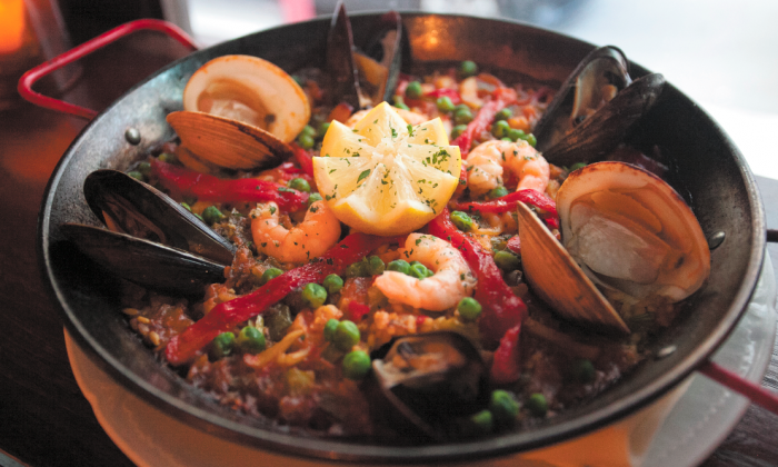 The seafood paella at Alcala, with squid, shrimp, prawns, clams, monkfish, and mussels. (Deborah Yun/Epoch Times)