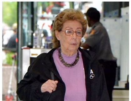 """Jacqueline Goldberg, 87, leaves the federal building May 17, 2013, in Chicago after testifying in a lawsuit against Donald Trump. On Monday, May 20, 2013, Goldberg, who alleged during a court appearance that Trump cheated her in a bait-and-switch scheme, has told jurors she had qualms about suing the developer-turned-TV star given his power and influence. Goldberg says """"The Apprentice"""" star enticed her into buying two condos at Chicago's Trump International Hotel & Tower with an offer to share profits of the entire building. (AP Photo/Chicago Sun-Times, Scott Stewart)"""