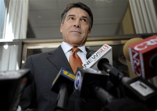 A file photo of Texas Gov. Rick Perry speaking to the media before hosting a lunch appointment with Connecticut gun makers in Hartford, Conn., Monday, June 17, 2013.  Perry celebrated the Supreme Court's decision on June 25 to strike down part of the Voting Rights Act that restricted Texas's autonomy in deciding its voting laws. (AP Photo/Jessica Hill)