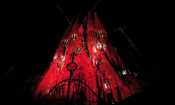 Red lights cover the Sagrada Familia basilica designed by architect Antoni Gaudi to commemorate World Aids Day on December 1, 2010 in Barcelona.  (LLUIS GENE/AFP/Getty Images)