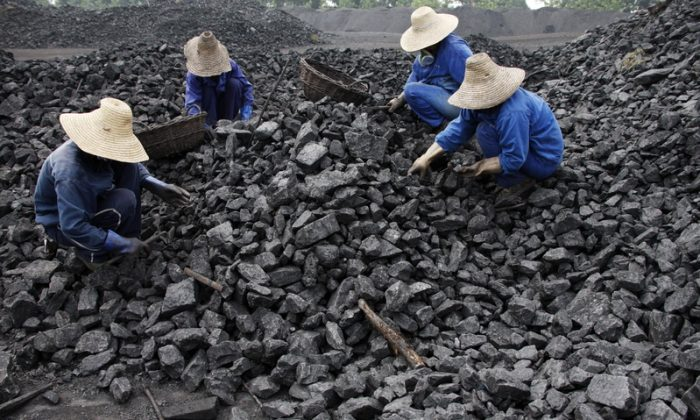 Chinese miners process coal from a mine in Huaibei, east China's Anhui province on July 13, 2010. (STR/AFP/Getty Images)