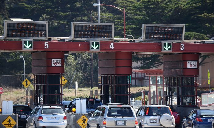 Cars pass through the Golden Gate Bridge toll plaza in San Francisco, Calif. A San Francisco lawmaker wants to change the law saying the city must buy new vehicles simply because they have grown old. (Justin Sullivan/Getty Images)