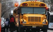 7-Year-Old Boy Struck in Fatal Accident, Pinned Between School Bus and Van