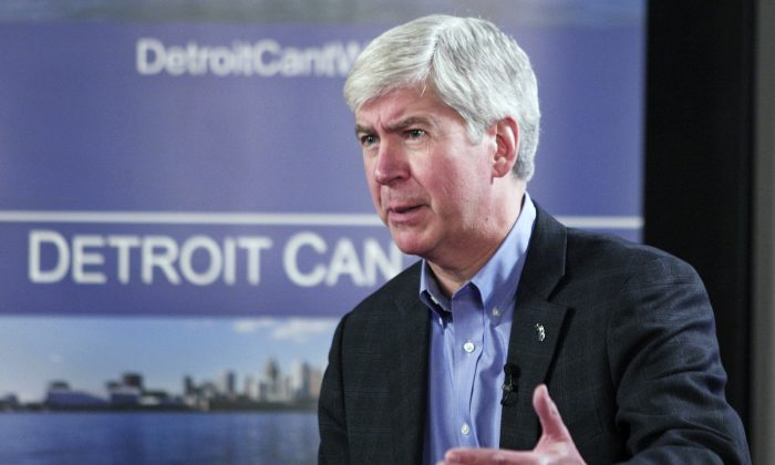 Mich. Gov. Rick Snyder announces his appointment of an emergency financial manager for the city of Detroit during a town hall meeting at Wayne State University in Detroit, March 1. Detroit has nearly $16 billion in debts and liabilities. (Bill Pugliano/Getty Images)