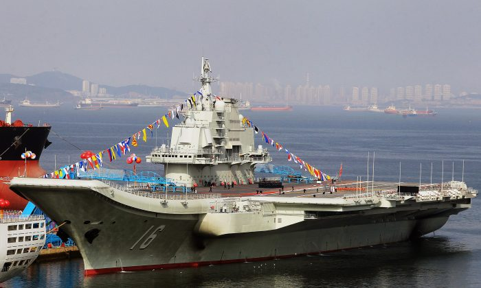 China's first aircraft carrier, a former Soviet carrier, after its handover to the People's Liberation Army navy in Dalian, northeast China's Liaoning Province, on Sept. 24, 2012. (AFP/Getty Images)