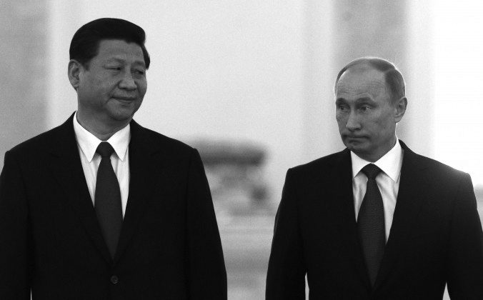Russia's President Vladimir Putin (R) and Chinese Chairman Xi Jinping meet in the Grand Kremlin Palace in Moscow, on March 22, 2013. An effort by Xi Jinping at the summit to gain Russian support for Chinese claims in the South China Sea failed. (Sergei Karpukhin/AFP/Getty Images)