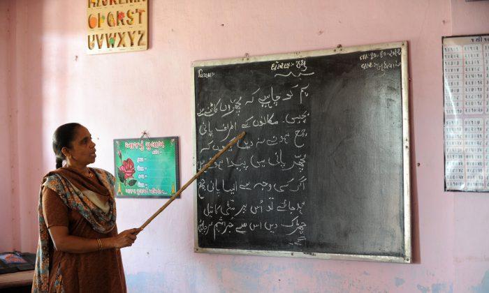 Urdu language teacher Afsana Khokhar teaches her students at Mahudha Urdu School at Mahudha in India (Sam Panthakya/AFP/Getty Images)