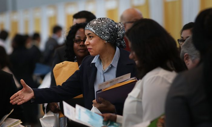 Job seekers meet with employers at the 25th Annual CUNY big Apple Job and Internship Fair at the Jacob Javits Convention Center on April 26 in New York City. Despite efforts unemployment among young people ages 18-29 remains high.  (Spencer Platt/Getty Images)