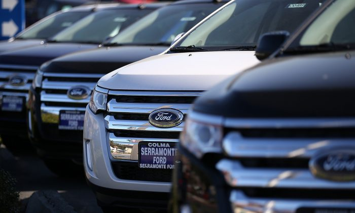 New Ford cars are displayed on the sales lot in Colma, Calif. If you genuinely need a new car, this may be the best time to get that good deal on financing, writes Peter Morici. (Justin Sullivan/Getty Images)