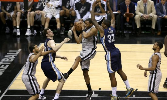 63507077bc4 Tracy McGrady  1 of the San Antonio Spurs grabs a rebound against Ed Davis