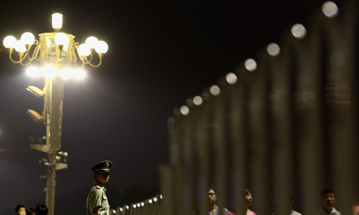 A Chinese paramilitary policeman stands guard on Tiananmen Square on June 3, 2013, in Beijing. (Feng Li/Getty Images)