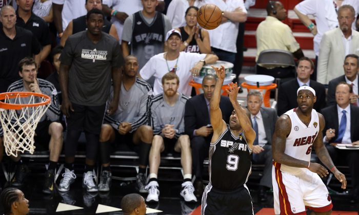 Tony Parker #9 of the San Antonio Spurs makes a shot with 5.2 seconds left in the fourth quarter against LeBron James #6 of the Miami Heat to ultimately win Game One of the 2013 NBA Finals at AmericanAirlines Arena on June 6, 2013 in Miami, Florida. (Christian Petersen/Getty Images)