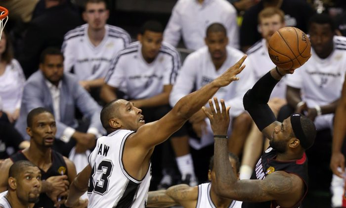 LeBron James #6 of the Miami Heat looks to shoot over Boris Diaw #33 of the San Antonio Spurs in the second half during Game Five of the 2013 NBA Finals at the AT&T Center on June 16, 2013 in San Antonio, Texas. (Mike Ehrmann/Getty Images)