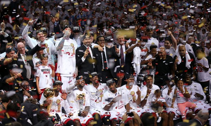 Tthe Miami Heat celebrate after defeating the San Antonio Spurs 95-88 to win Game Seven of the 2013 NBA Finals at AmericanAirlines Arena on June 20, 2013 in Miami, Florida. (Mike Ehrmann/Getty Images)