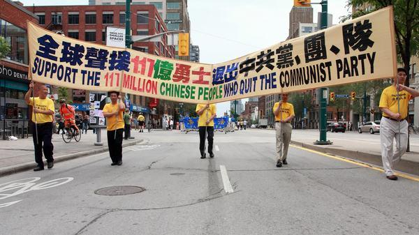Canadian Falun Gong practitioners participate in a parade to celebrate people who have quit the Chinese Communist Party, such as the 5,000 film projectionists.