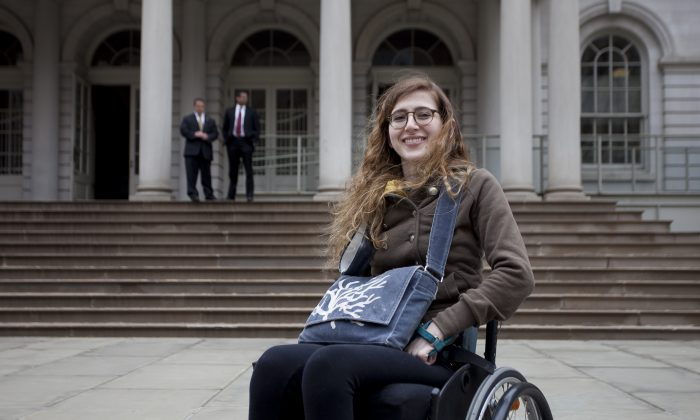 Manhattan resident GG deFiebre, 24, at City Hall on April 18, 2013, in New York City. DeFiebre supports a bill that would require all taxicabs in New York City to be wheelchair accessible. On June 6, a Court of Appeals ruled in favor of NYC, paving the way for 5,600 new wheelchair-accessible taxis in the five boroughs. Some advocates said the ruling is not perfect, but it is a start. (Samira Bouaou/The Epoch Times)
