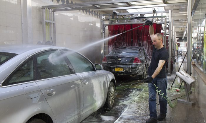 Miguel Portillo, seen washing a car at Jomar Car Wash in Flushing, joined his colleagues to vote in favor of unionizing on April 24. Jomar Car Wash is the sixth car wash to vote to unionize since Sept. 2012. Sunny Day Car Wash in the Bronx just finalized a union contract. (Samira Bouaou/Epoch Times)