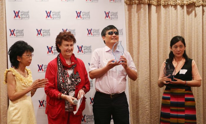 (L–R) Ann Lau, chair of Visual Arts Guild (VAG), Peggy Howards Chane, president of VAG, Chen Guangchen and Lhamo Tso, on behalf of her husband Dhondup Wangchen, receive Visual Artist Guild NYC Freedom of Speech Award, New York, June 1, 2013. (Gary Du/The Epoch Times)