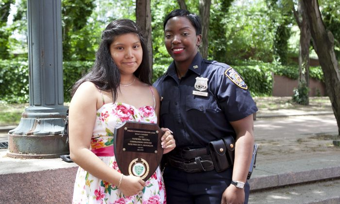 Police Officer Shantel McKinnes and essay contest winner Vanessa Vicuna outside of NYC Police Headquarters on June 5. (Samira Bouaou/The Epoch Times)