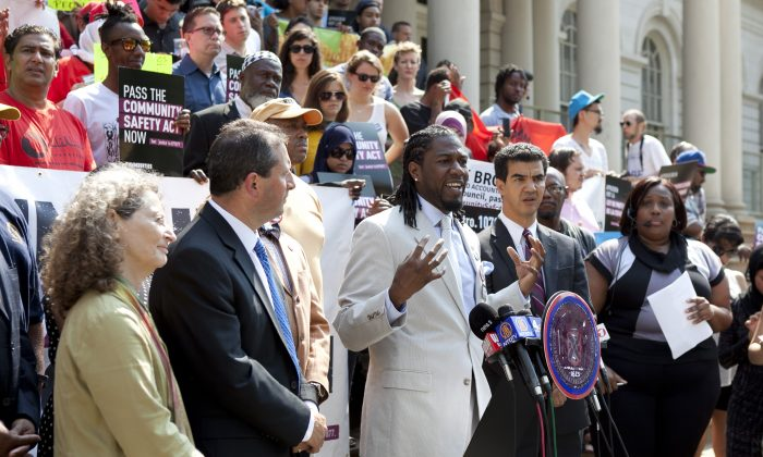 Council Member Jumaane D. Williams speaks in support of the Community Safety Act Bill on the City Hall steps, June 24, 2013. The bill was passed by City Council in a historic vote June 27, 2013. (Samira Bouaou/Epoch Times)