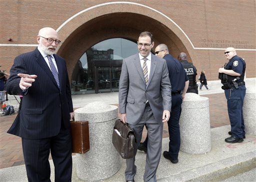 "Defense attorneys J.W. Carney Jr., left, and Henry Brennan, right, leave federal court in Boston, Monday, June 3, 2013, after a pre-trial hearing for accused mobster James ""Whitey"" Bulger. Jury selection begins Tuesday. (AP Photo/Elise Amendola)"